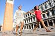 Travel couple in love having playful fun in Venice