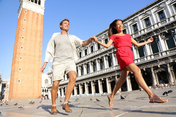 Travel couple in love having playful fun in Venice