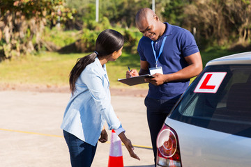 female african student driver pre test inspection