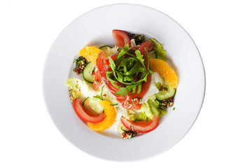 salad with red fish, tomatoes, cucumbers and oranges