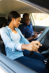 young african girl and driving instructor