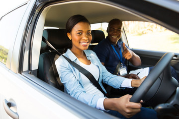 young african woman taking driving lessons