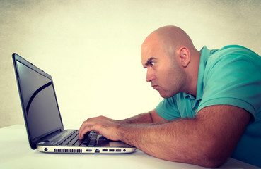 Man looking at laptop computer