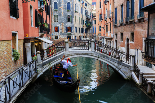 Venice, Italy - Gondolier and historic tenements - 69859576