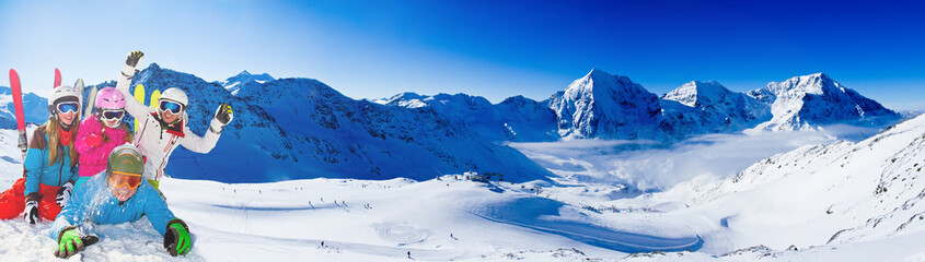 Skiing. Skiers enjoying winter vacation, panorama