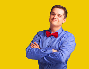 Casual man in shirt on yellow background.
