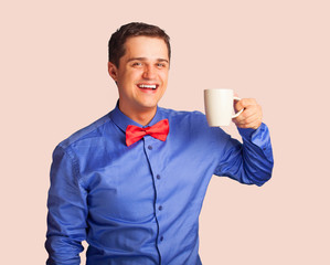 Happy man in shirt with cup of coffee