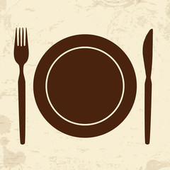 Plate,fork and knife on retro background