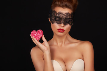 Beautiful sexy woman dark lace on eyes with cake shape of heart