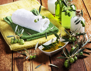 Spa massage setting with green olives