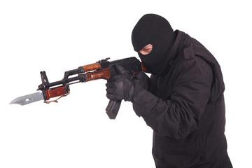 mercenary with AK 47 gun witn bayonet