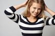 canvas print picture - beautiful girl in a striped sweater cute smiling