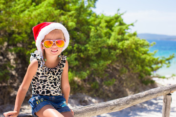 Cute beautiful little girl in Santa hat during vavation
