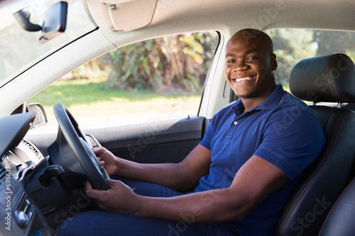 african man inside his new car - 69863301