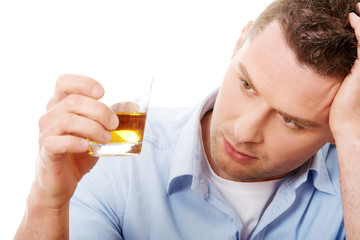 Yound man in depression, drinking alcohol