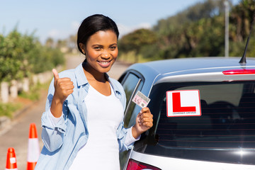 black woman showing a driving license