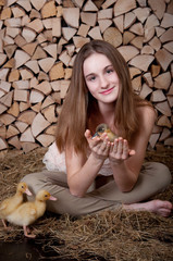 Cute girl with duckling has easter, girl with spring duckling