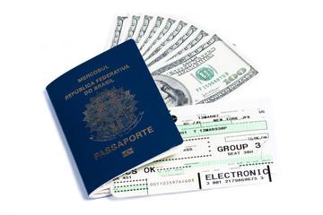 Brazilian passport, dollars and boarding pass