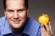 Diet nutrition. Happy man holding apple fruit