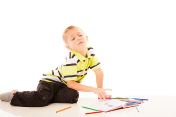 little boy child drawing with color pencils