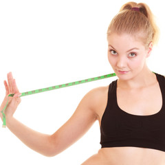 Diet. Fitness woman fit girl with measure tape