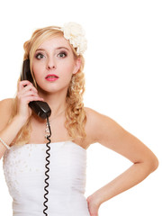 Wedding. Angry woman fury bride talking on phone
