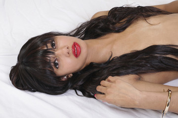 Attractive Black Woman Reclining Hair Covering Breasts