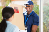 young african american delivery man delivering a package