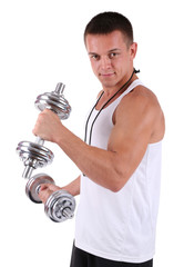 Young muscular sportsman execute exercise with dumbbells