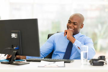 young african businessman working on computer
