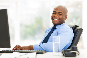 african businessman sitting in office looking at the camera