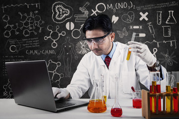 Asian scientist working in laboratory