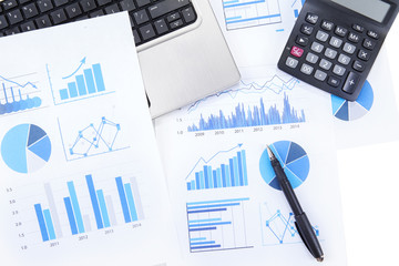 Business chart with laptop and calculator