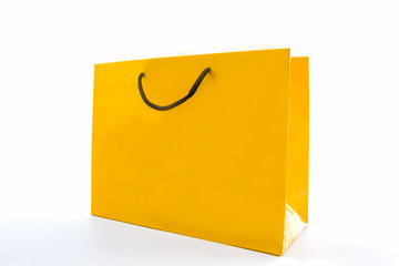 Blank yellow paper shopping bag.