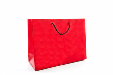 Blank red paper shopping bag .