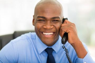 african businessman using landline phone