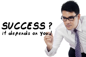Businessman writes motivation words 1
