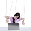 Businesswoman working like a slave 1