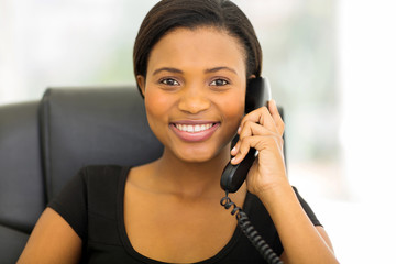african businesswoman talking on phone in the office