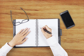 Hands making a plan on agenda book