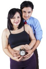 Happy family holding an alarm
