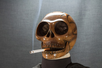 Human skull smoking a cigarette on a black background