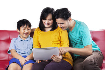Happy family using digital tablet