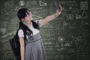 High school student taking self portrait