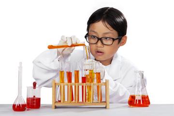 Little boy mixes the chemistry