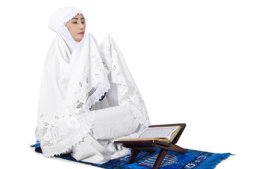 Muslim woman praying on traditional way