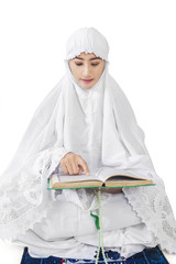 Muslim woman reads Kuran 2