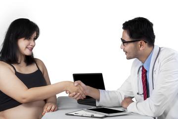 Pregnant woman getting congratulation