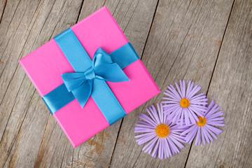 Purple gift box and gerbera flowers