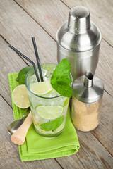 Fresh mojito cocktail and bar utensils